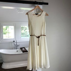 Off white dress with brown belt.  Size 10.